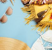 Diverse travel girlish stuff on colorful background blue and yellow, nobody tourism lifestyle concept Royalty Free Stock Image