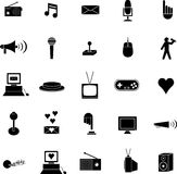 Diverse vector symbols or icons set. Vector set of diverse symbols or icons, including videogames, computers, bullhorns, television, and others Royalty Free Stock Images