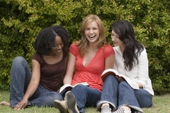 Diverse woman in a small group reading. Royalty Free Stock Photography