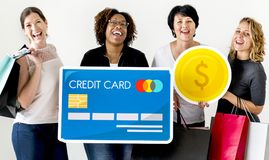 Diverse women carrying money icons Royalty Free Stock Images