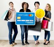 Diverse women carrying money icons Royalty Free Stock Photo