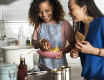 Diverse women cooking in the kitchen together Royalty Free Stock Images