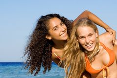 Diverse, women, fun at beach stock photography