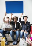 Diverse woman holding blank board. Diverse women holding blank board Royalty Free Stock Photos