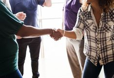 Diverse women shaking hands together stock image