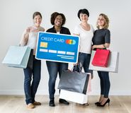 Diverse women with shopping icons Stock Photo