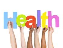 Diverse Word van de Mensenholding Gezondheid Royalty-vrije Stock Fotografie