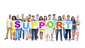 Diverse Word van de Mensenholding Steun Stock Foto