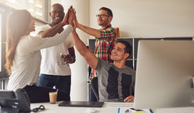Diverse workers celebrating something in office Stock Images