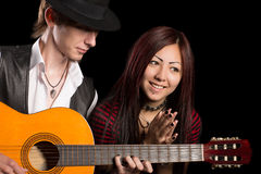 Diverse young couple music Stock Photos