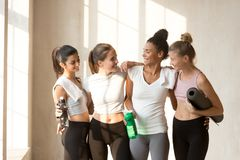 Diverse young women talking resting after workout royalty free stock image