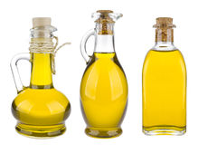 Diverses bouteilles d'huile d'olive d'isolement sur le fond blanc Image stock