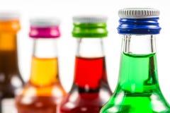 Diverses bouteilles d'isolement de liqueur avec des boissons de partie Images stock