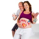 Diversión de la pintura con embarazo Fotos de archivo