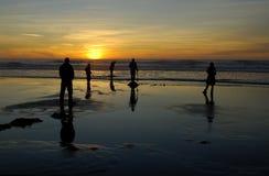 Diversión de la playa en la puesta del sol Imagen de archivo libre de regalías