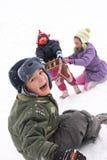 Diversión de los niños en la nieve Foto de archivo libre de regalías