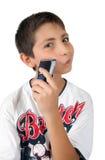 Diversión del cabrito y mejilla el afeitar con la maquinilla de afeitar Foto de archivo libre de regalías