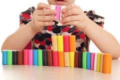 Diversión del niño con plasticine fotografía de archivo libre de regalías