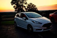 Diversión rápida del coche de la puesta del sol de la fiesta del St fotos de archivo libres de regalías