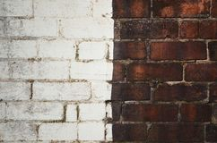 Diversity Old brick wall background wallpaper. Diversification Brick wall half painted white with copy space stock images
