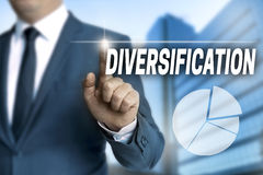 Diversification touchscreen is operated by businessman.  stock photo