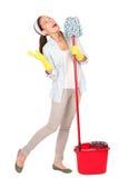 Diversión del canto de la mujer de la limpieza Fotos de archivo