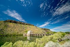 Diversion Dam on the Boise River with clouds in the sky and reflection. Landmark diversion Dam rejection in the Boise river on a spring day stock photography