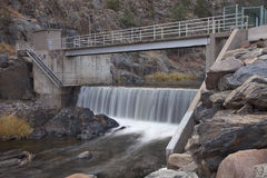 Diversion dam on a mountain river stock photo