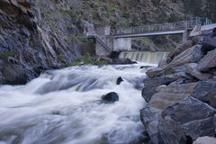 Diversion dam on a mountain river flowing in deep, Royalty Free Stock Photography