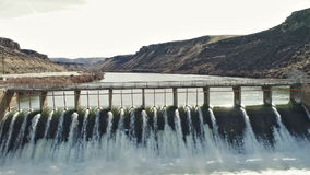 Diversion Dam during the spring high water run off stock video footage