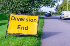 Diversion end sign on pedestrian footpath uk road Royalty Free Stock Photos