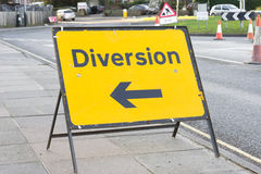Diversion. Yellow diversion sign in a UK city street stock photography