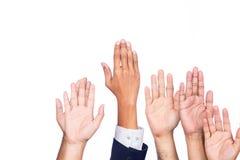 Diversità delle mani di affari sollevate Fotografia Stock