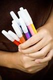 Diversiteit van kleurrijke teller op handen Stock Afbeelding