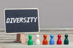 'diversiteits' concept, gekleurde raadsstukken met chalboard Stock Afbeelding