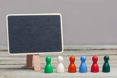 'diversiteits' concept, gekleurde raadsstukken met chalboard Royalty-vrije Stock Foto's