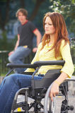 Diversity. Lonely girl is sitting on a wheelchair on the street Royalty Free Stock Images