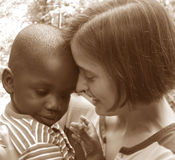 Diversity. Small African American child with Caucasian Woman Stock Photography