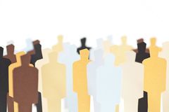 Diversity. A group of diverse people on white background. Shallow DOF. Focus on the central yellow figure Royalty Free Stock Photo