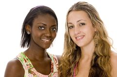 Diversity. Two attractive young women of different race Royalty Free Stock Photography