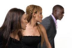 Diversity among adults. Two women and man, of different ethnic backgrounds, looking at something in distance; against white background Stock Images