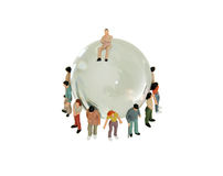 Diversity around the Globe. A variety of people grouped together to represent diversity around a crystal globe with navigational lines Royalty Free Stock Image