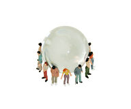 Diversity around the globe. A variety of people grouped together to represent diversity around a crystal globe with navigational lines Royalty Free Stock Photography