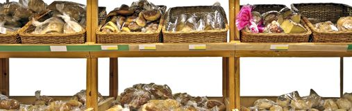 Diversity of bread in the cupboard Royalty Free Stock Image