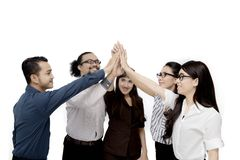 Diversity business people make a high five gesture. After business meeting , isolated on white background Royalty Free Stock Photo