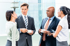 Diversity business team with coffee in office royalty free stock photo