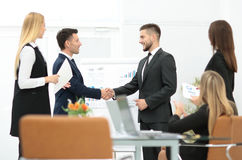 Diversity business team concluding contract with handshake in a Stock Photo
