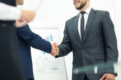 Diversity business team concluding contract with handshake in a Stock Images