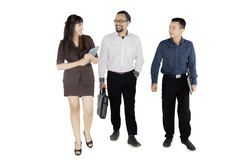 Diversity business team discussing job on studio. Full length of diversity business team discussing job while walking together in the studio, isolated on white Royalty Free Stock Image
