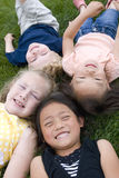 Diversity in childhood. A group of diverse young kids playing Royalty Free Stock Photo